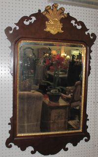 """Antique Mahogany Wall Mirror Antique Mahogany Wall Beveled Mirror. Measures 46"""" tall x 28-1/2"""" wide. Overall condition is good. Some moulding losses (see close-up photos). Starting Bid $30. Auction Estimate $30 - $150."""