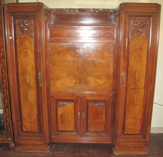 """Art Deco Style Secretary Cabinet Large, Art Deco Style Secretary Cabinet. Circa 1940's. Measures 71-1/2"""" tall x 68"""" wide x 19"""" deep. Overall condition is good to fair. No damage. Breaks down for shipping. Starting Bid $50. Auction Estimate $50 - $250."""