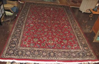 "Semi Antique Persian Rug 12' 10"" x 9' 3"" Large, Semi Antique Persian Rug. Handmade. Measures 12' 10"" x 9' 3"". Overall condition is good to fair. One corner has damage (see close-ip photos). Wear consistent with age. Starting Bid $50. Auction Estimate $50 - $300."