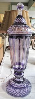 "Amethyst Cut Crystal Floor Vase Large Amethyst Cut Crystal Lidded Floor Vase. Measures 45"" tall x 14"" wide. Overall condition is Excellent. No damage. Signed ""Merzle"" on lid. Starting Bid $500. Auction Estimate $500 - $1,000."