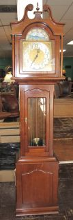 "Daneker ""President"" Grandfather Clock  Daneker ""President"" Grandfather Clock. Cherry Case. Westminster Chime. Tall Case Clock measures 79"" tall x 19"" wide x 11-1/4"" deep. Condition is Very good. Works great. No damage. Starting Bid $150. Auction Estimate $150 - $300."