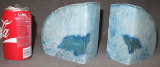 """Large Brazilian Dyed Agate Bookends Pair (2) of Large Brazilian Polished Agate Bookends. Each stands 5-1/2"""" tall x 5-1/2"""" wide x 3"""" thick. Condition is Excellent. Mint. No damage. Starting Bid $30. Auction Estimate $30 - $90."""