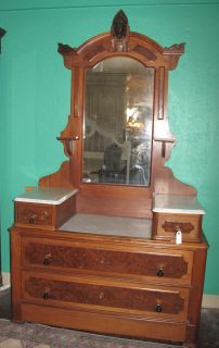 "Antique Victorian Dresser & Mirror  Antique Victorian Drop Well Dresser & Mirror with Marble Tops. Measures 83"" tall x 47-1/2"" wide x 21"" deep. Condition is Very good. Starting Bid $300. Auction Estimate $400 - $800."