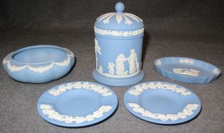 5 Pieces of Misc Wedgwood  5 Pieces of Misc Wedgwood. Marked on bottom. Condition of all is Very good. No damage. Starting Bid $30. Auction Estimate $30 - $80.