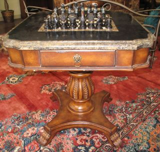 """Pedestal Chess Backgammon Game Table Pedestal Chess Backgammon Game Table with Chess Set. 1 Drawer. Stands 31"""" tall x 30-1/2"""" wide x 30-1/2"""" deep. Marble Gameboard Flips over for Backgammon. Condition is good. No damage. 1 Queen in set has chip. Starting Bid $250. Auction Estimate $250 - $750."""