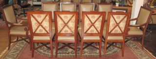 "Set of 10 Leather Dining Chairs Set of 10 Leather Dining Chairs. 2 Arm Chairs and 8 Side Chairs. Slightly used condition. No rips or tears. Arm Chairs measures 39-1/2"" tall x 23-1/2"" wide x 26"" deep. Side Chairs measure 39-1/2"" tall x 19-1/2"" wide x 26"" deep. Starting Bid $250 for all. Auction Estimate $250 - $700."
