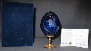"""Faberge' Swan Lake Cobalt Crystal Egg Faberge' Imperial Swan Lake Cobalt Crystal Egg. Limited Edition #85 of 600. Etched with an image of a ballerina and swan. Made in St. Petersburg, Russia. Original numbered Certificate included as well as fitted Gift Box. Measures 6-3/4"""" tall. Condition is Excellent. Mint. No damage. Starting Bid $250. Auction Estimate $600 - $700."""