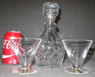 """Waterford Crystal Decanter & 2 Glasses Waterford Crystal Decanter & 2 Glasses. Decanter measures 9-1/2"""" tall. Glasses are each 3-1/2"""" tall. Condition is Excellent. Mint. No damage. All are marked on bottom. Starting Bid $50. Auction Estimate $50 - $120."""