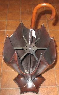 """Umbrella Holder Umbrella Form Umbrella Holder or Stand. Measures 38"""" tall x 14"""" wide. Condition is Very good. No damage. Starting Bid $80. Auction Estimate $80 - $200."""