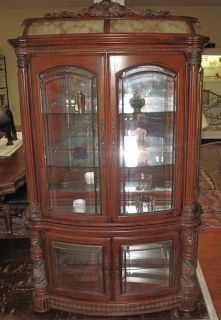 """Large """"Villa Valencia"""" Display Cabinet Large """"Villa Valencia"""" 4 door Display Cabinet. The """"Villa Valencia Collection"""" by Michael Amini. 4 Glass Doors. Measures 91"""" tall x 56"""" wide x 22"""" deep. Condition is Very good. No damage. Starting Bid $400. Auction Estimate $1,000 - $1,500."""