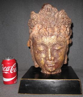 """Cast Bronze Buddha Head Cast Bronze Buddha Head on a Wood Base. Measures 16"""" tall on base. Base measures 9-1/2"""" wide x 9-1/2"""" deep. Condition is good. No damage. Starting Bid $60. Auction Estimate $80 - $200."""