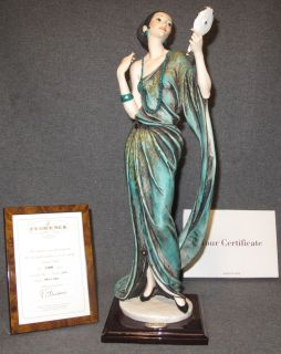 """Giuseppe Armani Sculpture """"Cleo"""" Giuseppe Armani Sculpture """"Cleo"""". #801C. Retired. Limited Edition #130 of 5000. She stands 18"""" tall. Condition is good. No damage. Includes COA. Starting Bid $70. Auction Estimate $70 - $200."""