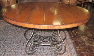 """Bernhardt Round Dining Table Bernhardt Round Dining Table with Iron Base. Measures 30"""" tall x 54"""" wide. Condition is good. No damage. Starting Bid $150. Auction Estimate $200 - $300."""