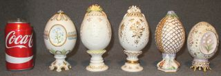 "5 Cybis Porcelain Eggs 5 Cybis Porcelain Eggs. Each is between 5"" to 6-1/2"" tall. Condition is Excellent. Mint. No damage. All are marked on bottom. Starting Bid $60. Auction Estimate $80 - $120."