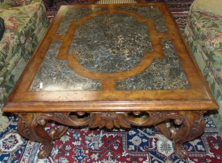 "Maitland-Smith Marble Inlaid Coffee Table Beautiful Maitland-Smith Marble Carved Wood and Inlaid Coffee Table. Measures 22"" tall x 52-1/2"" wide x 40-1/2"" deep. Condition is very good. No Damage. Starting Bid $200. Auction Estimate $250 - $500."