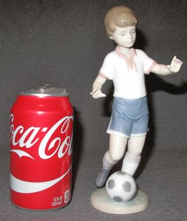 "Lladro Porcelain Figure #6198 Soccer Practice Lladro Porcelain Figure #6198 Soccer Practice. Measures 8-3/4"" tall. Condition is Excellent. Mint. No damage. Bottom is marked. Starting Bid $70. Auction Estimate $70 - $100."