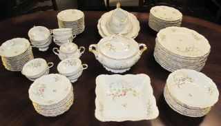 """83 pc Edelstein Dishes Set """"Bianca"""" Vintage 83 piece Edelstein Bavarian Maria Theresia Dishes Set in the """"Bianca"""" Pattern. Includes; 11 Dinner Plates at 10"""", 12 Lunch Plates at 8"""", 12 Side Plates at 6"""", 8 Bowls at 8"""", 12 small Bowls at 5-1/2"""", 10 Cups, 12 Saucers, 1 Gravy Boat, 1 Lidded Casserole, a Square Serving Bowl at 9"""" and 2 Serving Platters. 1 is 13"""" and 1 is 15"""". Condition is good. No damage. Starting Bid $80. Auction Estimate $80 - $200."""