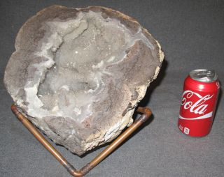 """Large Quartz Geode Cluster  Large Quartz Geode Agate Cluster with Calcite on a stand. Measures 5-1/4"""" tall x 10-1/2"""" wide x 12"""" deep. Condition is Very good. No damage. Starting Bid $150. Auction Estimate $150 - $300."""