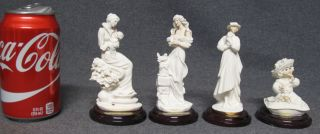 "4 Mini Giuseppe Armani Sculptures 4 Mini Giuseppe Armani Sculptures. 3 are 5"" tall and one is 3-1/2"" tall. Condition is Very good. No damage. Starting Bid $60. Auction Estimate $60 - $120."