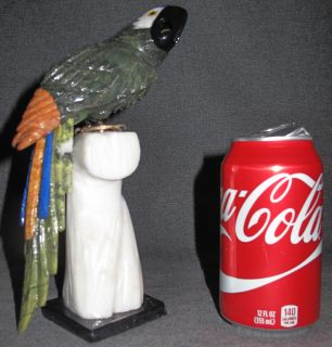 "Hand Carved Semi-Precious Stone Macaw Sculpture Hand Carved Semi-Precious Stone Macaw or Parrot Sculpture. Beautifully carved with semi precious stones on its tail and multi colored Jaspers. Measures 9-3/4"" tall x 3-1/2"" wide. Condition is Excellent. No Damage. Starting Bid $50. Auction Estimate $50 - $90."