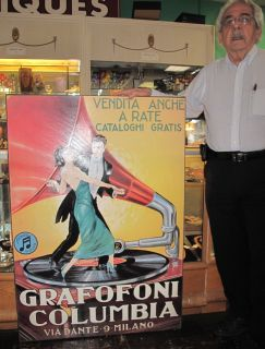 """Grafofoni Columbia Art Print on Canvas Large, Grafofoni Columbia Art Print on Canvas. Measures 50"""" tall x 35"""" wide. Condition is Very good. No damage. Starting Bid $60. Auction Estimate $100 - $200."""