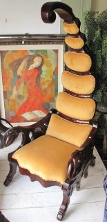 """MAHOGANY """"SCORPION"""" CHAIR Unusual Mahogany """"Scorpion"""" Chair with Ultra Suede Upholstery. Measures 78"""" tall x 31"""" wide x 40"""" deep. The scorpion's claws serve as the arm rests, the back as the seat, and its curling tail as the massive headrest. Condition is Very good. No damage."""