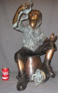 """BRONZE BOY with FROGS FOUNTAIN SCULPTURE Bronze Boy with Frogs Fountain Sculpture. High Quality Bronze with excellent Detail and patina. Sculpture functions as a fountain as well and is pre-Fitted to accept Water Pump for Fountain Feature. Measures 29"""" tall x 17"""" wide. Condition is Brand New, Mint. No Damage at all."""