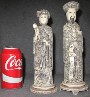 """CHINESE CARVED BONE EMPEROR & EMPRESS PAIR Pair of Exquisitely Detailed & Carved Bone Chinese Figures. Emperor figure measures 10-1/2"""" tall. Empress is 9-3/4"""" tall. Condition of both is good. No damage. Base is missing feet on Empress (see photos)."""
