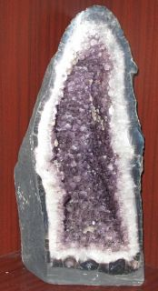 """HUGE BRAZILIAN AMETHYST QUARTZ CATHEDRAL 126.5 Lbs.  Huge Amethyst Quartz Geode Cathedral from Brazil. Weight is 126.5 pounds. Measures 27"""" tall x 13"""" wide x 11"""" deep. Condition is Very good. No damage."""