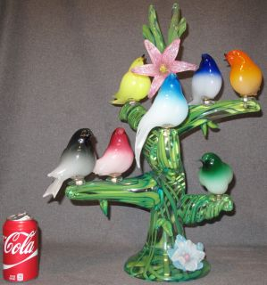 """MURANO GLASS BIRDS in TREE by ENRICO CAMMOZZO Large Murano Art Glass 7 Birds on Tree Sculpture signed by """"Enrico Cammozzo"""". Measures 23"""" tall x 16"""" wide x 12"""" deep. Some damage to 4 of the birds and a repair on a flower (see close-up photos)."""