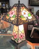 "Wonderful Floral Stained Glass Table Lamp Wonderful 4 sided Stained Glass Table Lamp. Beautiful Floral Pattern. 3 Ways action. Lights up Top, Bottom or Both. Measures 22"" tall x 13"" wide. Condition is Excellent. No damage. Starting bid $100. Auction Estimate $120 - $200."