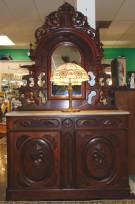 "Antique Victorian Walnut and Marble Top Sideboard  Antique Victorian Carved Walnut and Marble Top Sideboard with Mirror. Circa 1880. Measures 89"" tall x 53"" wide x 19"" deep. Condition is good. Minimal wear typical from age. Starting Bid $600. Auction Estimate $700 - $900."