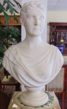 "Antique Carved Marble Bust by C.H. Hemenway  Rare Antique Carved Marble Bust of a Woman by C.H. Hemenway (active 1870's). Back is inscribed ""C.H. Hemenway - Sculptor - Prov R.I. 1876"". Measures 28"" tall x 18"" wide. Condition is very good. No damage. Starting Bid $600. Auction Estimate $700 - $900."