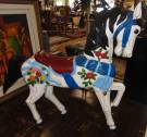 "Antique Carousel Horse by Marcus Charles Illions (1871-1949) Antique Painted Carousel Horse believed to be carved by Marcus Charles Illions (1871-1949). Condition is good. Paint losses typical of age. No damage. Stands 60"" tall x 60"" long. Starting Bid $2500. Auction Estimate $3500 - $4000."