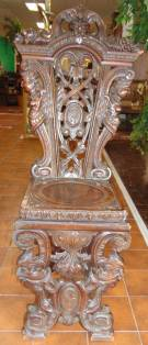 "Antique Renaissance Carved Walnut Hall Chair Antique European Renaissance Carved Walnut Hall Chair. Circa 1880. Carved with various faces, winged figures, acanthus leaves, and shield adorning the backrest and front legs. Stands 48-1/2"" tall x 22"" wide. Condition is good. Minor wear and scratches typical from age. Starting Bid $600. Auction Estimate $700 - $800."