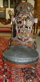 "Antique Carved Walnut Slipper Chair  Antique Carved Walnut Slipper Chair. Circa 1870. Measures 41"" tall. Measures 41"" tall. Condition is good with some wear and scratches typical from age. Starting bid $100. Auction Estimate $200 - $400."