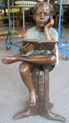 "Bronze Sculpture of a Boy Reading Lovely Bronze Sculpture of a Seated Boy Reading a Book. High Quality. Stands 36"" tall. Condition is New. Excellent. No damage at all. Starting bid $400. Auction Estimate $500 - $600."