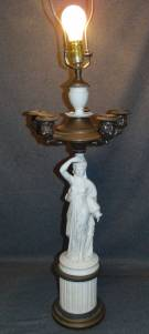 "Vintage Bisque Porcelain Figural Table Lamp Vintage Bisque Porcelain Figural Table Lamp. 5 Candelabra Arms. Stands 28"" tall. Measures 46"" total to finial. Condition is good with some wear and scratches typical from age. No damage. Starting Bid $250. Auction Estimate $300 - $400."