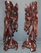 "2 Vintage Oriental Figural Carvings 2 Vintage Oriental Figural Carvings. Each Measures 21"" tall. Condition is fair to good. Some cracks and losses with minimal wear. Some repairs. Starting Bid $100. Auction Estimate $120 - $150."