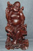 "Vintage Oriental Carving of Laughing Buddha with Children Vintage Oriental Figural Carving of Laughing Buddha with Children. Measures 15-1/4"" tall. Condition is fair to good. Some cracks and losses with minimal wear. Some repairs. Starting Bid $70. Auction Estimate $80 - $100."