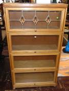 "Vintage Oak Lawyers 4 Stack Bookcase Vintage Oak Lawyers 4 Stack Bookcase. One piece unit. Top Stack has leaded glass. Measures 60"" tall x 33"" wide. Condition is good. Starting Bid $200. Auction Estimate $240 - $280."