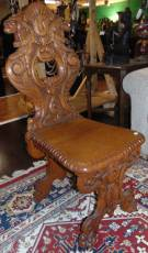 "Antique Carved Oak Sgabello Chair  Antique Carved Oak Sgabello Chair. Measures 42-1/2"" tall x 18"" wide x 22"" deep. Condition is very good with minimal wear. 1 small chip on back side (see close-up photo). Several Shipping Options Available. Starting Bid $150. Auction Estimate $250 - $300."