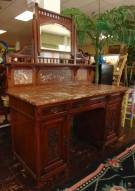 "Antique Carved Walnut Marble Top Desk with Mirror Antique Carved Walnut Marble Top Desk with Mirror. Measures 70"" tall x 51"" wide x 25"" deep. Condition is very good with minimal wear. No damage. Several Shipping Options Available. Starting Bid $150. Auction Estimate $250 - $350."