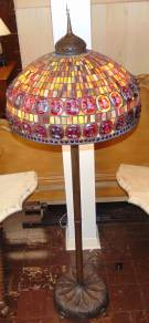 "Tiffany Style Turtleback Stained Glass Floor Lamp Magnificent, Tiffany Style ""Turtleback"" Stained Glass Floor Lamp. Vibrant Colors. Heavy, Bronze Base and Large Leaded Shade with Turtlback Glass Tiles. Measures 79"" tall x 26"" wide. Condition is very good. No Damage. Several Shipping Options Available. Starting Bid $1,500. Auction Estimate $1,800 - $2,500."