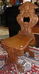 "Antique Carved Oak Sgabello Chair  Antique Carved Oak Sgabello Chair. Measures 42-1/2"" tall x 18"" wide x 22"" deep. Condition is very good with minimal wear. 1 small chip on back side (see close-up photo). Several Shipping Options Available. Starting Bid $250. Auction Estimate $300 - $350."