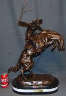"Bronze ""Bronco Buster"" Sculpture after Frederick Remington Western Bronze ""Bronco Buster"" Sculpture after Frederick Remington on a Triple Marble Base. Signed. Very Heavy Piece. This Sculpture is made entirely from Bronze with a Marble Base. Measures 28"" tall x 18"" long. Condition is New, Mint. No Damage. Several Shipping Options Available. Starting Bid $400. Auction Estimate $450 - $550."