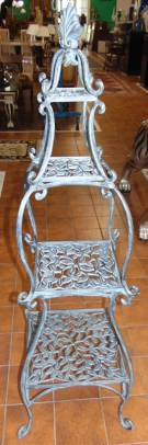 "Ornate Cast Aluminum Plant Stand Etagere'  Ornate Cast Aluminum Plant Stand Etagere'. Measures 59"" tall x 14"" wide. Condition is Like New. Very good. No Damage. Several Shipping Options Available. Starting Bid $200. Auction Estimate $220 - $250."