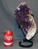 "Large Amethyst Crystal Geode on Iron Stand 14"" Beautiful & Large Brazilian Amethyst Crystal Geode on Iron Stand. Measures 14"" tall. Condition is very good. New condition. No Damage. Starting Bid $200. Auction Estimate $225 - $300."