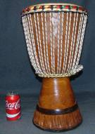 "African Djembe Drum African Djembe Drum. Authentic African Ceremonial Art. A djembe or jembe is a rope-tuned skin-covered goblet drum played with bare hands, originally from West Africa. Measures 19-1/2"" tall x 12"" wide. Overall condition is good. Wear consistent with age. Several Shipping Options Available. Starting Bid $80. Auction Estimate $100 - $150."