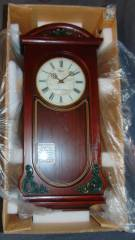 "Seiko Wall Clock  Seiko Wall Clock. New in the box. Battery operated. Westminster chimes. Measures 23"" tall x 10-1/2"" wide. Condition is Like New. Very good. No Damage. Starting Bid $50. Auction Estimate $60 - $80."